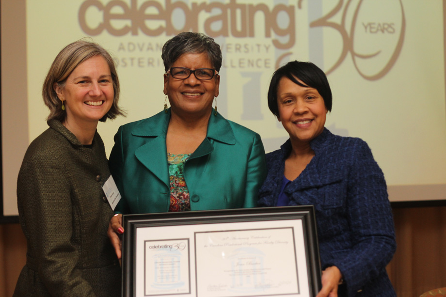 The first CPPFD Fellow, Joan Barber (center), receiving recognition from Eliana Perrin, the Associate Vice Chancellor for Research (left),and Sibby Anderson Thompkins, Director of the Office of Postdoctoral Affairs.