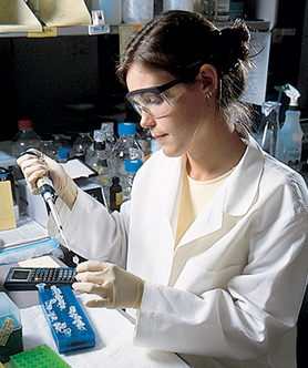 Medical student Diana Borton treats cell lines with hormones aspart of a study of female infertility. 2000 by Will Owens