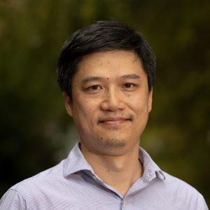 Headshot of Greg Wang.