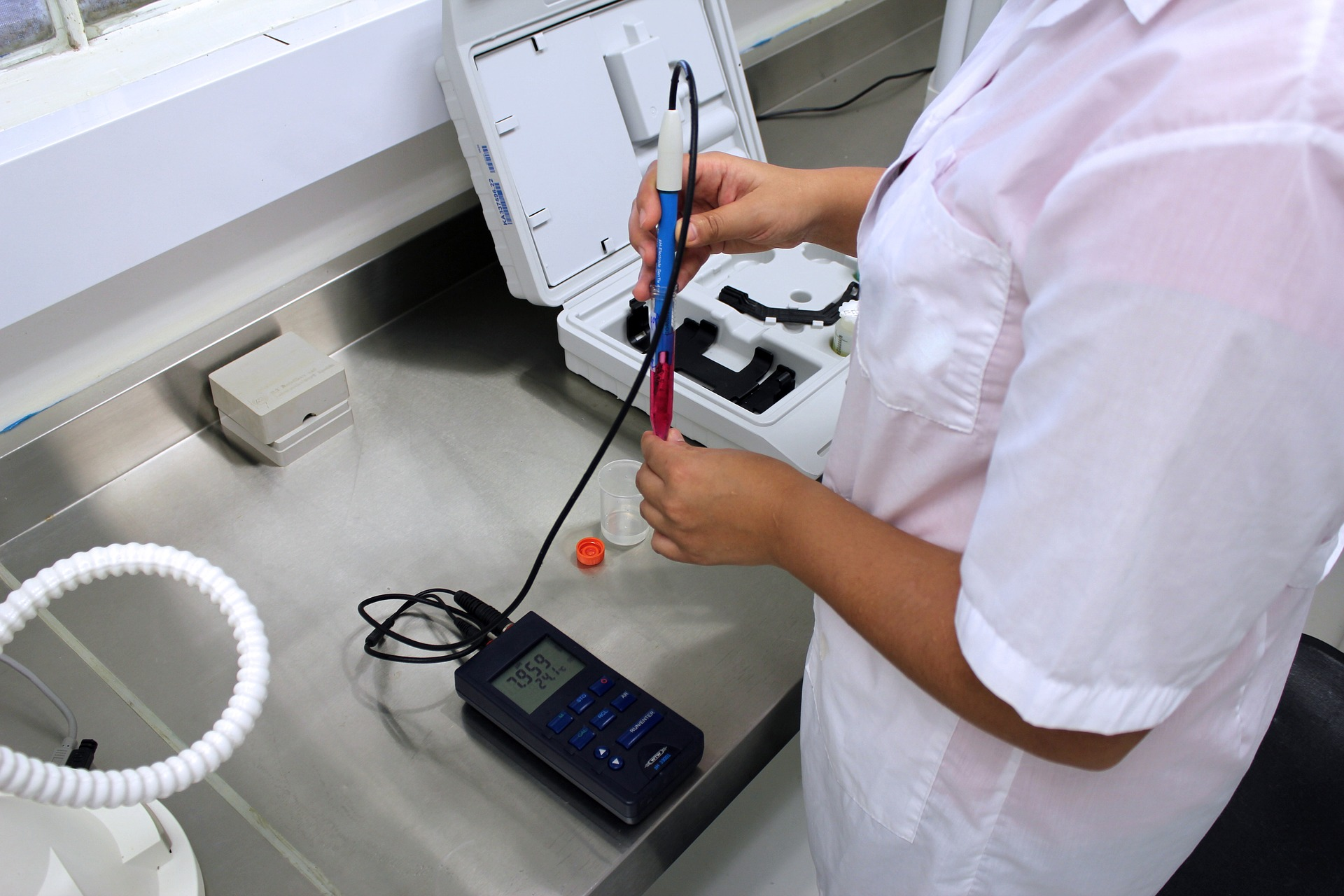A person in a lab uses lab equipment.