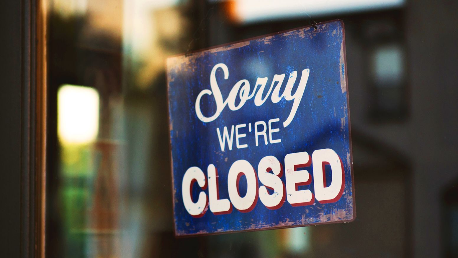 """""""sorry we're closed"""" sign in a window"""
