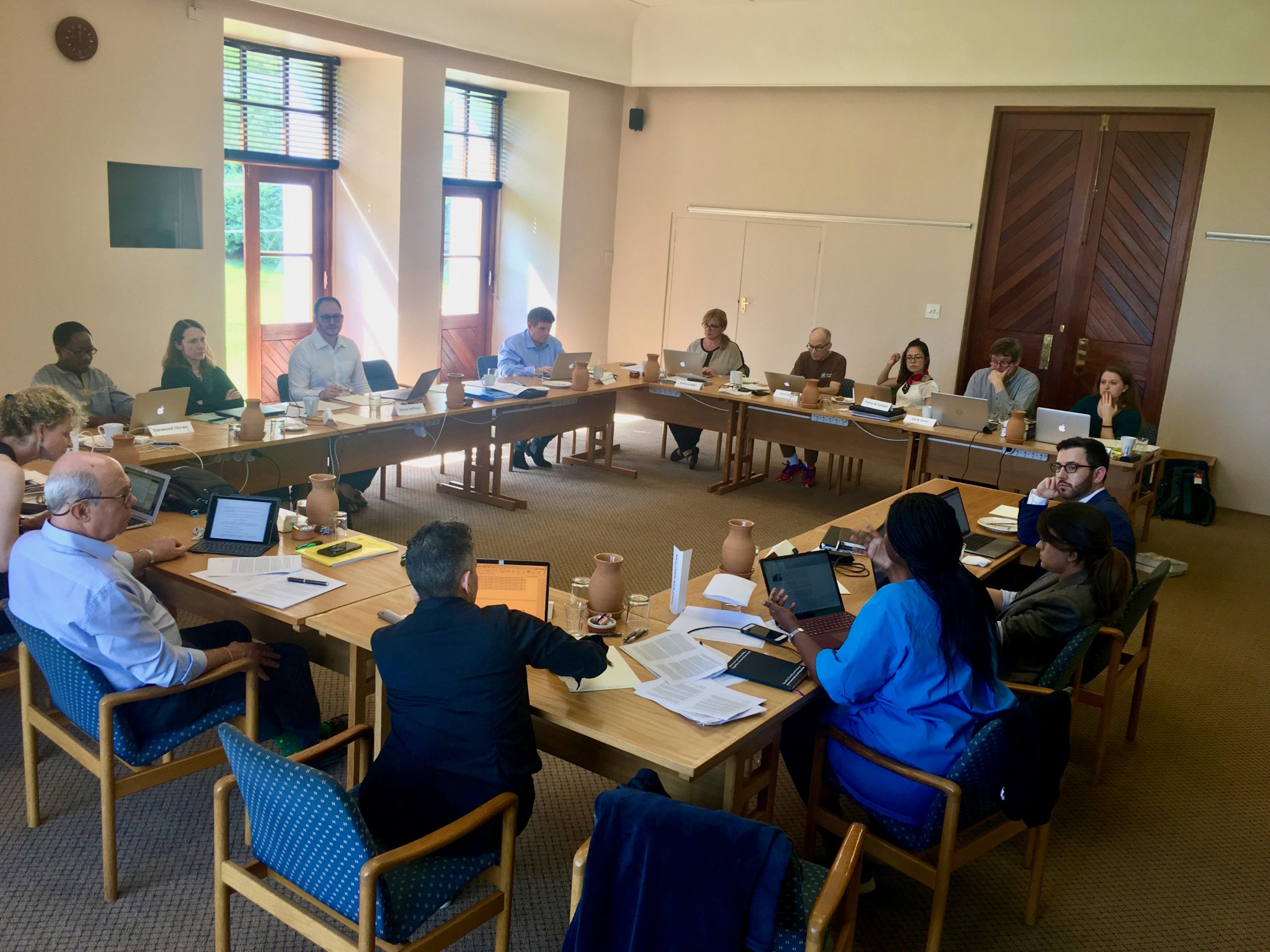 Benjamin Mason Meier (right) discusses law reforms to prevent disease with the Global Health Law Consortium in Stellenbosch, South Africa, in April 2019.