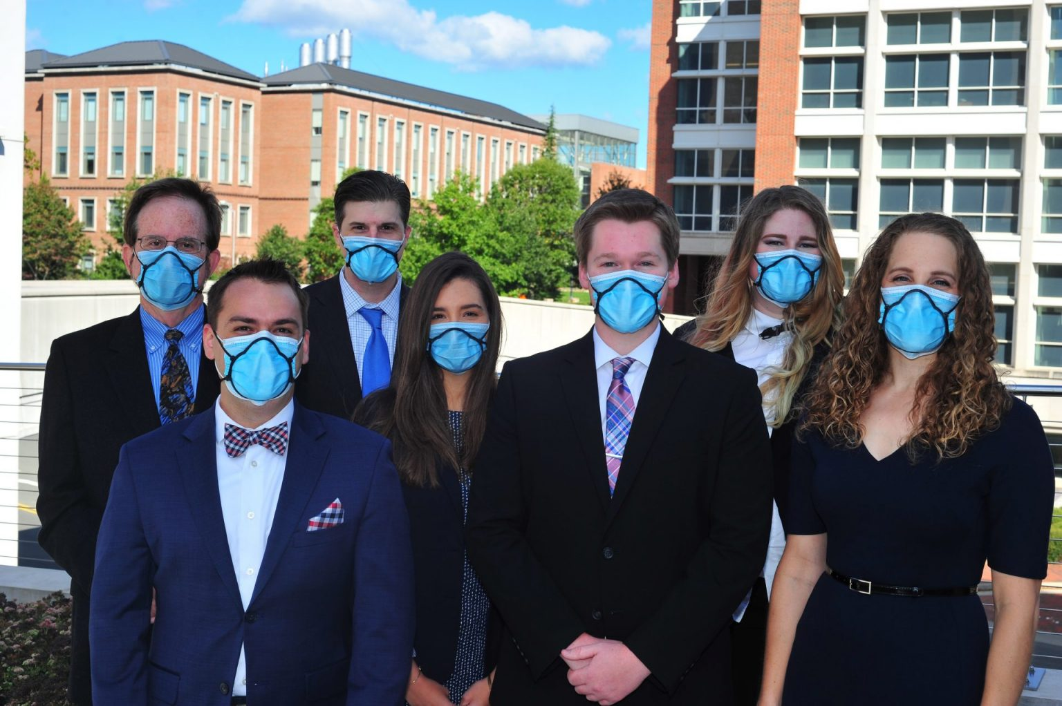 a group of students wear Devin Hubbard's mask